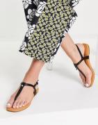 UGG – Madeena – Sandalen aus schwarzem Leder
